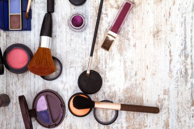 make up objects on wooden background