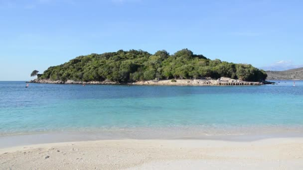 video of blue clear sea water, island with trees and plants, Ksamil Village in Albania