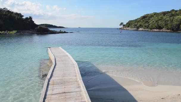 video of blue clear sea water and wooden pier, Albania Sarande