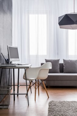 Designer's workspace in a modern apartment