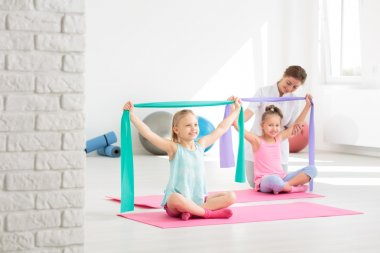 Correcting their posture with fun