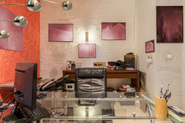 Modern artist's cluttered home atelier