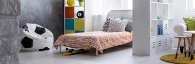 Comfy sleeping space hidden behind a practical screen