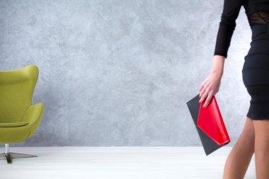 Beautiful woman with red handbag