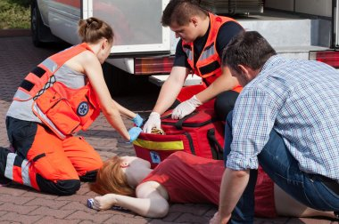 Emergency service helping woman