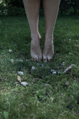 Toes touching the grass