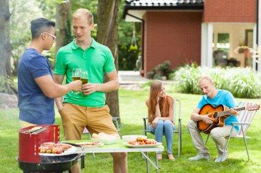 Friends talking on a garden party