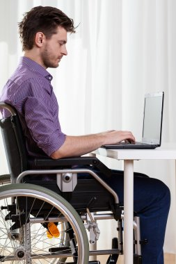 Disabled man surfing on the Internet