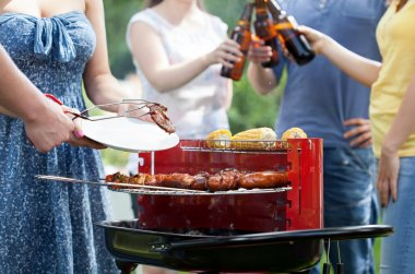 Friends having party with barbecue