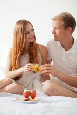 Young marriage with breakfast in bed