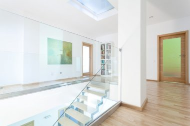 Modern hallway with glass staircase