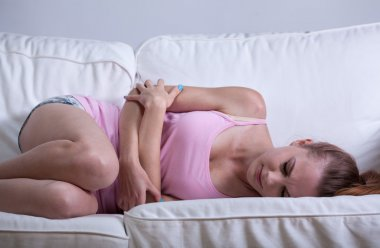 Young girl having abdominal cramps
