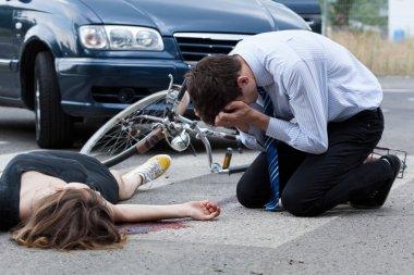 Dead woman on the pedestrian crossing