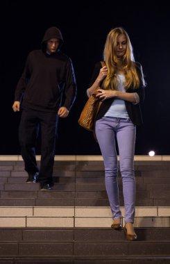 Man following woman at night