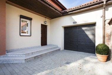 House entrance next to garage