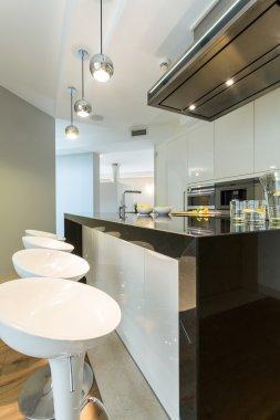Designer chairs in modern kitchen