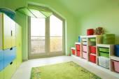 Fotografie Zimmer mit grün gestrichenen Wänden