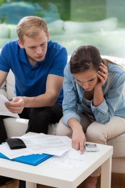 Couple analyzing home budget