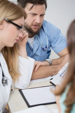 Doctors consulting during medical meeting