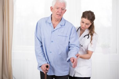 Patient using walking stick