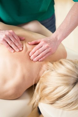 Masseur kneading back muscles