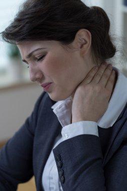 Office worker having neck pain