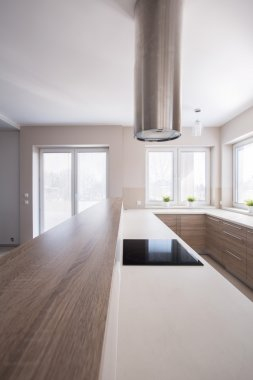 Wooden worktop in bright kitchen