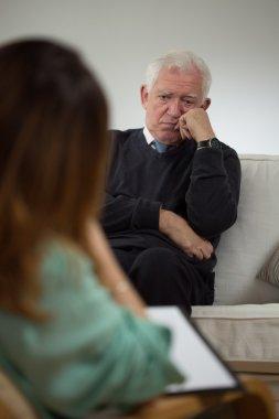 Elderly man at psychotherapist