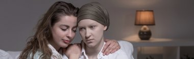 Friend supporting cancer woman
