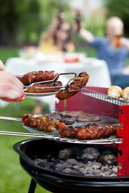 Barbecue with grilled sausages