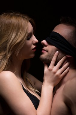 Man having kiss with covered eyes
