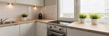 Wooden worktops and white cupboards