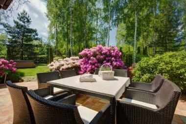 Patio furniture in beautiful garden