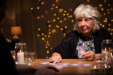 Elder female telling someones fortune