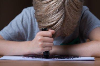 Sad boy doodling