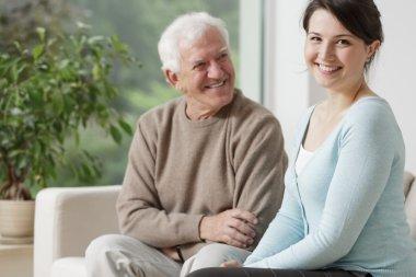 Smiling grandpa and caring granddaughter