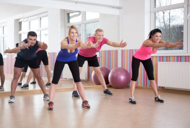 People exercising in pilates room