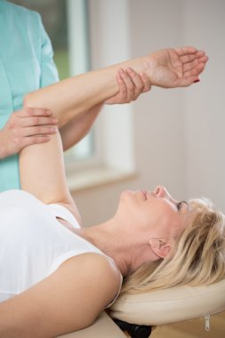 woman exercising  at physiotherapist