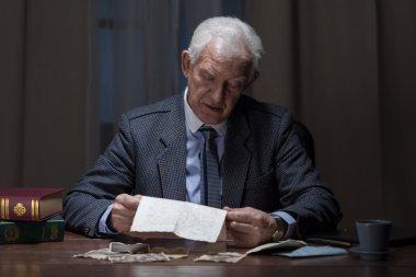 old businessman analyzing legal documents