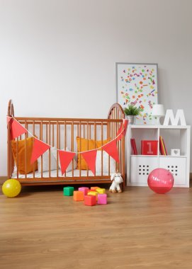Wooden furniture in babygirl room