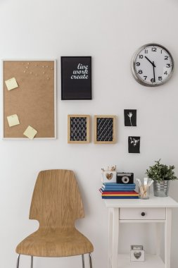 Bulletin board and wooden chair