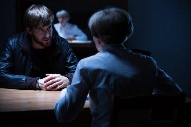 Interrogation in a dark room