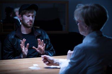 Junkie man interrogated by policewoman