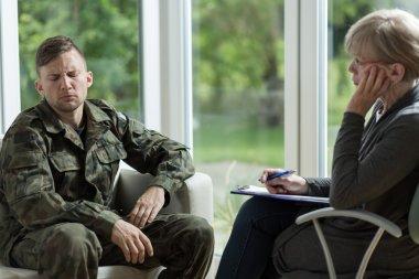 Psychologist talking with despair soldier