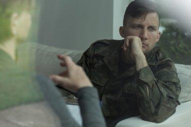 Despair soldier receiving psychological advice
