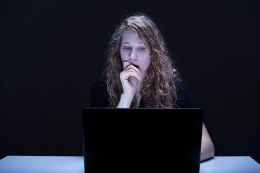 Frightened female using computer