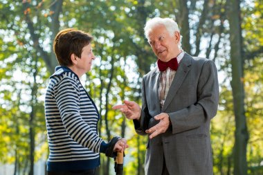 Senior man talking with woman