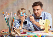 Creative male babysitter with child