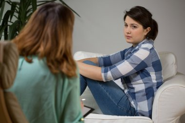 Young woman during psychological therapy