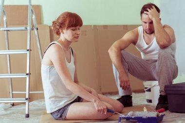 Despair couple renovating house